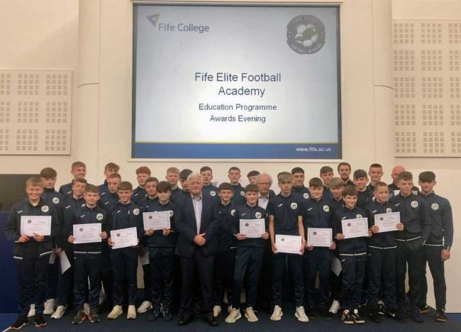 Fife Elite Football Academy players are pictured with their SQA certificates. Hugh Hall, Fife College principal (front), and Henry McLeish, chair of the academy, are also pictured.