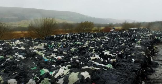 Central Fife Times: Waste pile of black silage wraps on farm.