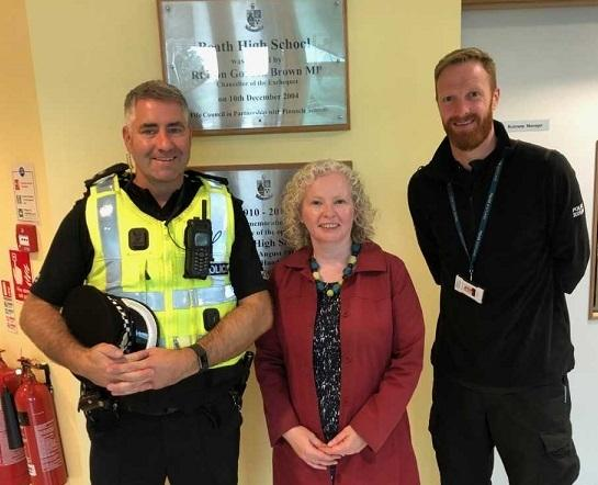 Claire Baker with Inspector Cameron and PC McDougall.