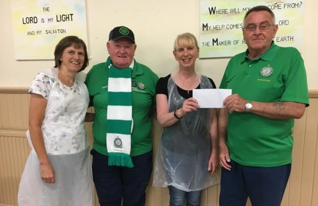 Budgie and Joey hand over the cheque to Lo'gelly Lunches.