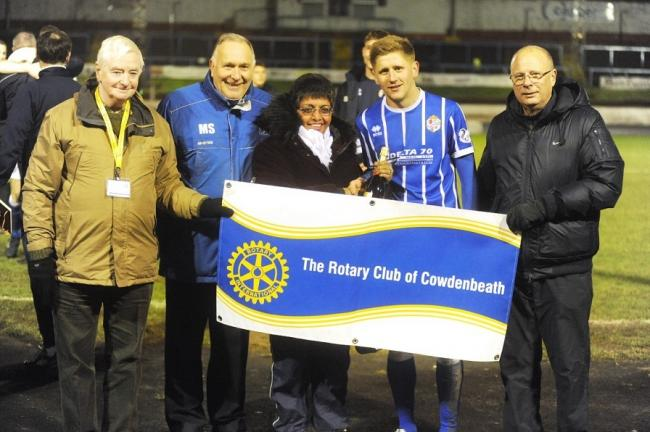 Robbie Buchanan gets his man of the match award from the rotarians.