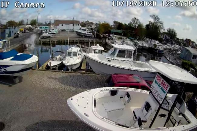 A vehicle plunges into a canal in Lindenhurst, New York