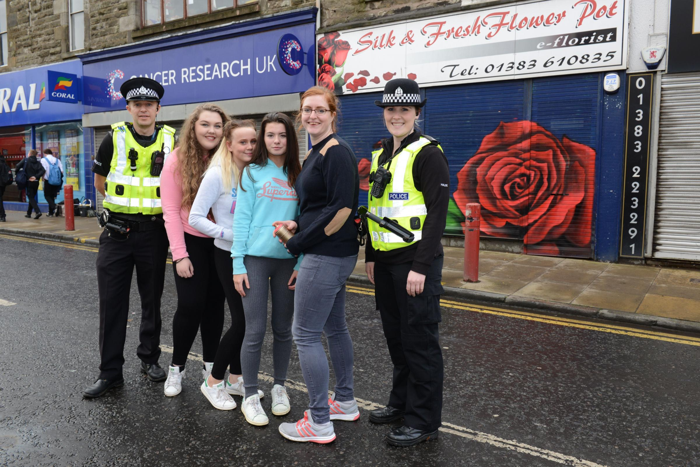 Chloe Scott; Olivia McPherson and Jordan Brown, with artist Kerry Wilson and community police team members Barry Smith and Brittany Primeau.