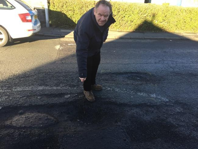Alex Campbell pointed out some of the potholes.