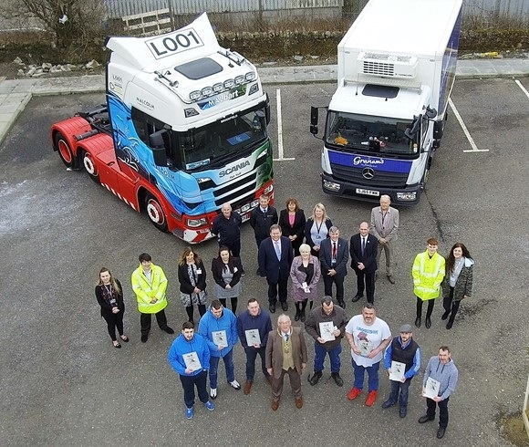 Provost Jim Leishman with some of the people training to become truck drivers.