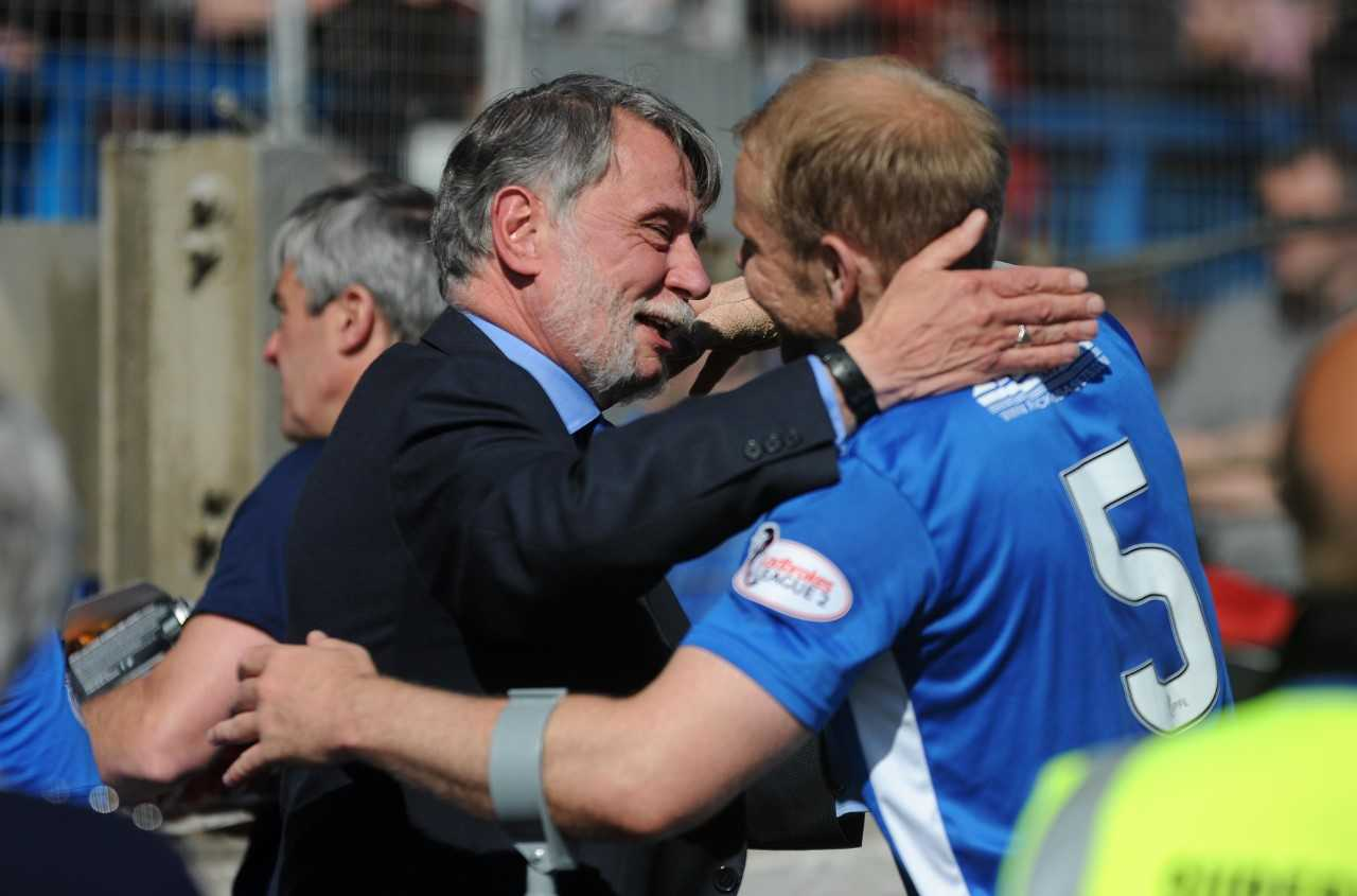 Cowden chairman Donald Findlay congratulates Bryan Gilfillan on his performance against Cove.