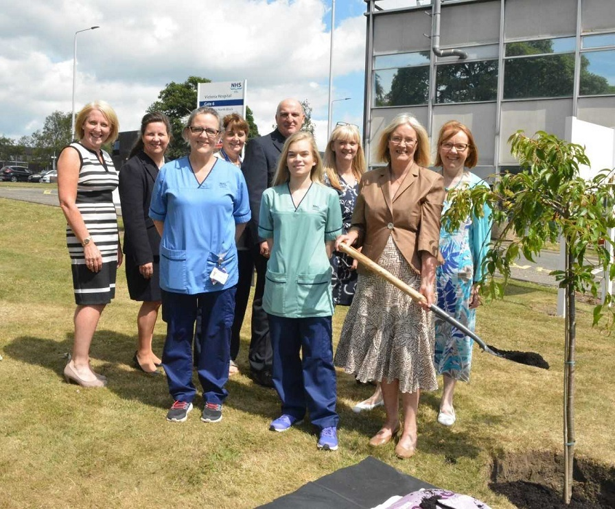 Tricia Marwick plants a tree to mark the 70th birthday of the NHS in Fife.