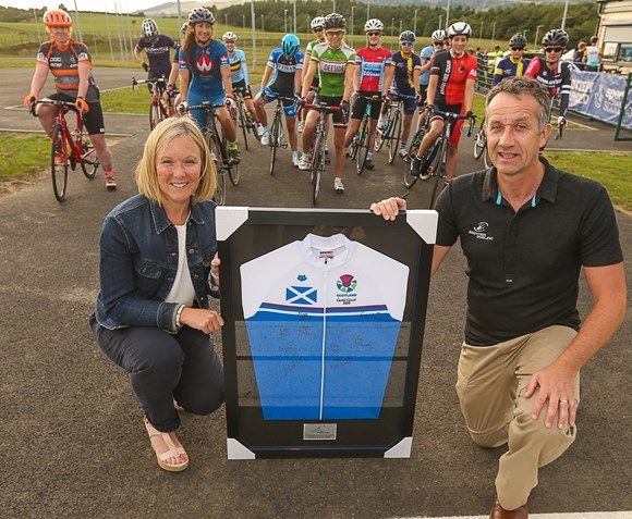 Sarah Roxburgh accepts the scotland top from Tom Bishop.