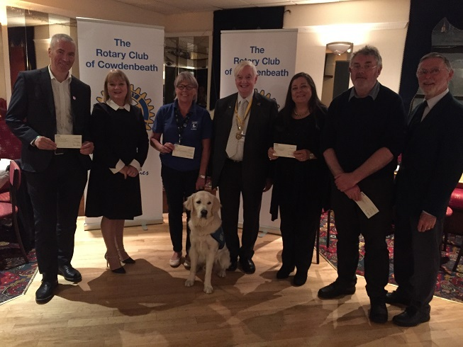 Representatives from the organisations receive their cheques.