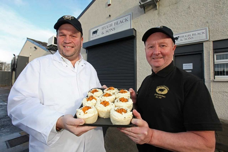 Willie Kemp (right) and owner Craig Black show off the company's award-winning Alloway Pies.