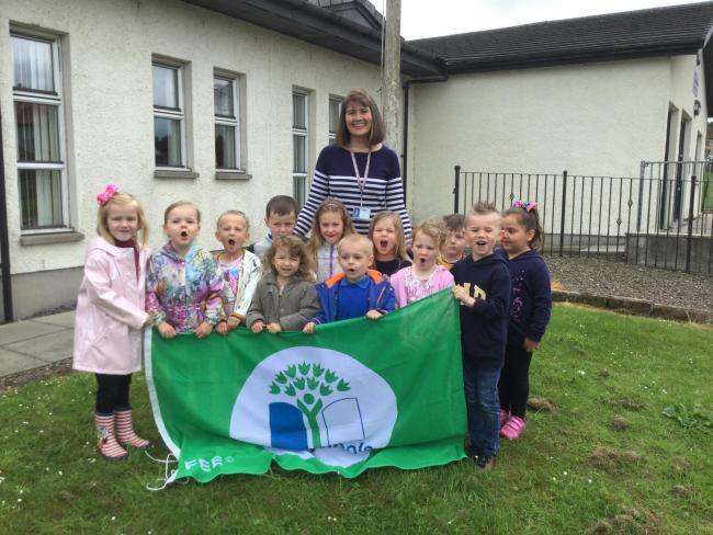 The delighted Clentry youngsters with their flag.